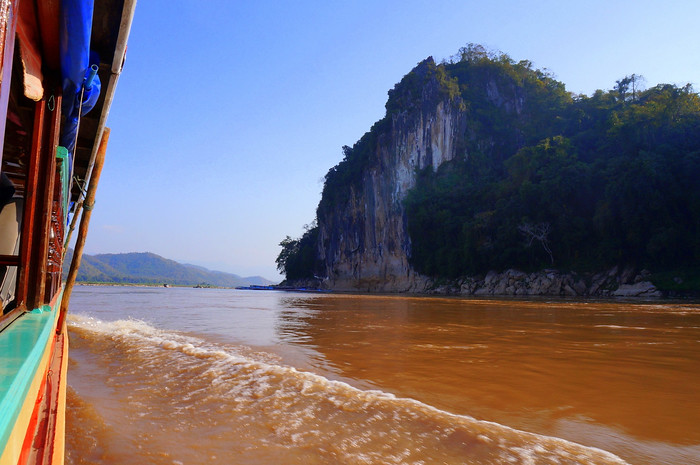 Limestone cliffs and caves on the shores of the Mekong, Laos.