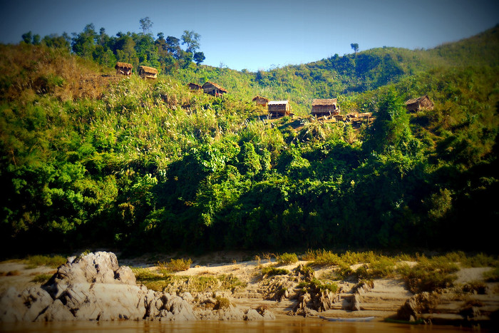 Bamboo huts on the banks of the Mekong River in Laos.