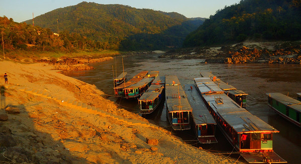 Our slow boats that we'd be taking down the Mekong river to Luang Prabang, Laos