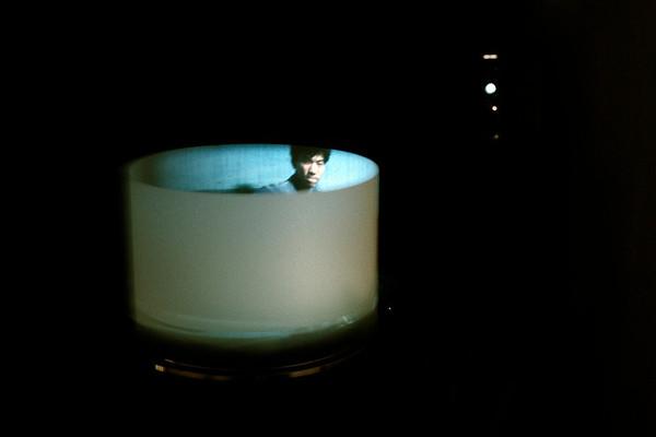 Lapping Loop installation view super-8 film loop, turntable, mylar, mirror 1992
