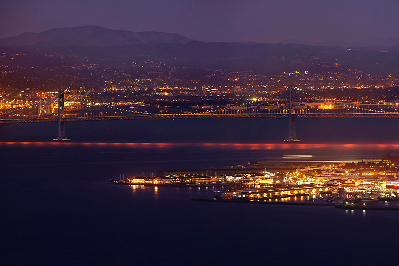 Photo #1 of 4 from a 30,000 pixel-wide panorama of San Francisco.  This photo can be printed at 4 feet wide with fine resolution of every window with a Marin view!  The entire panorama is available at www.patricksmithphotography.com and can be printed at 16 feet wide with fine resolution!  The entire east side of San Francisco is visible from the Marin Headlands just as the city lights become as bright as the daylight on a very clear evening.  The original photo is a stitched panorama created with the Canon 5D MkII consisting of two l photos tall and 7 photos wide for a total 29677 pixels wide x 4466 high with the Canon 500mm F4 lens.   Explore the city!