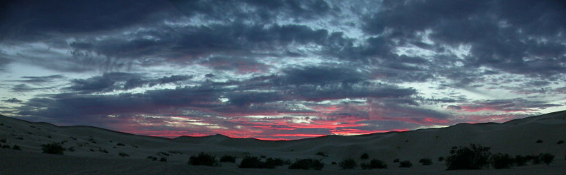 Sunset in Buttercup valley in the Imperial sand dunes.  Dec 19th 2003 shot with Nikon 4500 and stitched from three images.
