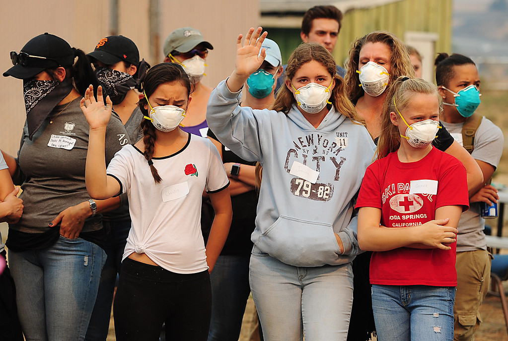 . VALLEJO, CA- OCT. 11, Volunteers wear face masks as they get work assignments at the large animal evacuation center at the Solano County Fairgrounds in Vallejo on Wednesday. (Chris Riley/Vallejo Times-Herald)