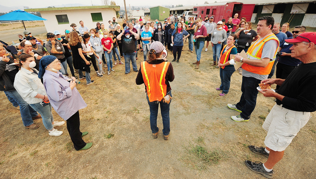 . VALLEJO, CA- OCT. 11, Volunteers listen to instructions before getting assignments at the large animal evacuation center in Vallejo on Wednesday. (Chris Riley/Vallejo Times-Herald)