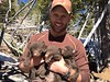 Michael Wardle with black bear cub triplets