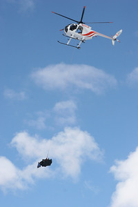 Helicopter carrying a moose during a moose transplant on January 16, 2006.  Photo by Phil Douglass, Utah Division of Wildlife Resources.
