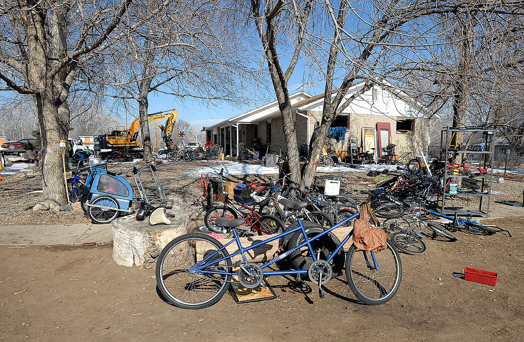 . Piles of bicycles rest in the yard at 860 4th St. SE in unincorporated Loveland while crews demolish the home on Monday, Feb. 11, 2019. Larimer County deemed two buildings on the property to be a threat to public safety because of code violations including hazardous levels of methamphetamines.  (Photo by Jenny Sparks/Loveland Reporter-Herald)