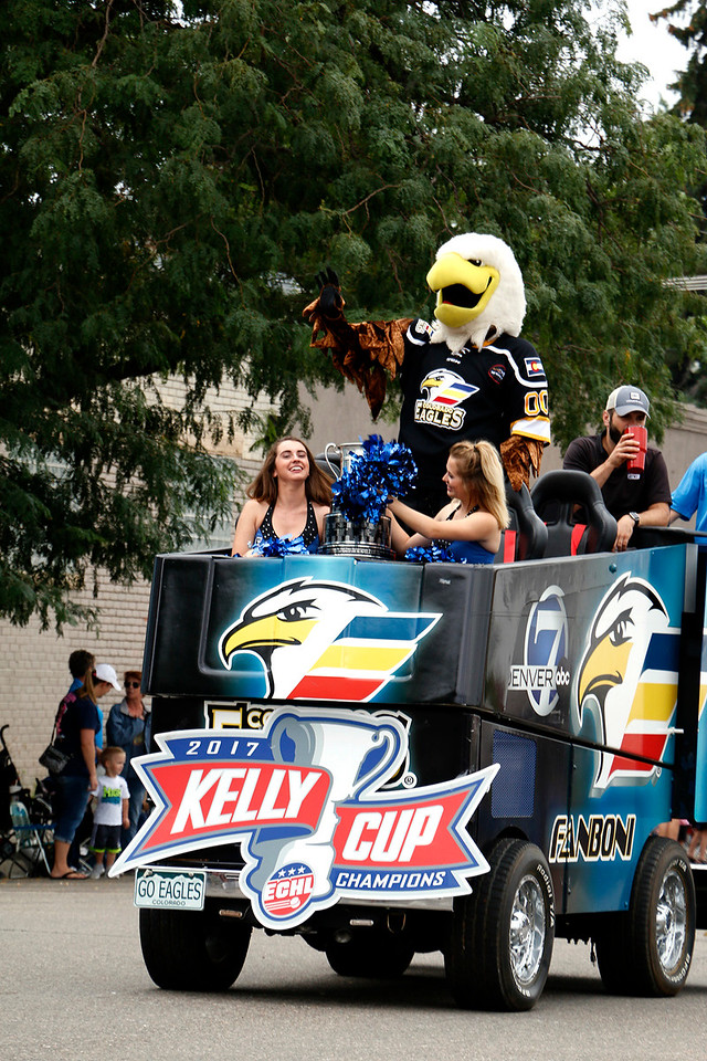 Eagles cheerleaders carry the Kelly cup through Larimer County Fair Parade July 29, 2017 with Slapshot in tow in downtown Loveland. (Michelle Risinger/ Loveland Reporter-Herald)