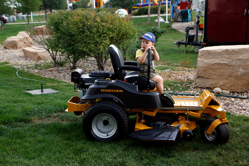 Reid Suter, 2, plays pretend Friday, August 4, 2017 as he sits on a riding lawn mower at the Larimer County Fair.(Michelle Risinger/ Loveland Reporter-Herald)