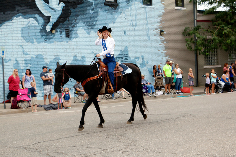Sharidan Higgins, 17, rides through downtown Loveland Saturday, July 29, 2017 as First Contender in Larimer County Fair Parade. (Michelle Risinger/ Loveland Reporter-Herald)