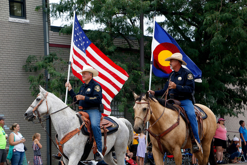 Larimer County Sheriff's Posse reps the American and Colorado flag Saturday, July 29, 2017 at the Larimer County Fair Parade in downtown Loveland. (Michelle Risinger/ Loveland Reporter-Herald)