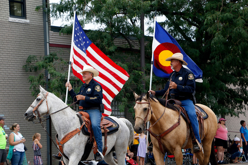 . Larimer County Sheriff\'s Posse reps the American and Colorado flag Saturday, July 29, 2017 at the Larimer County Fair Parade in downtown Loveland. (Michelle Risinger/ Loveland Reporter-Herald)