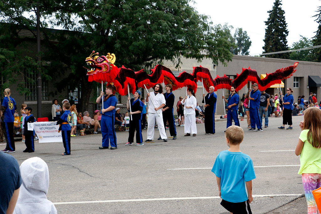 . Martial arts students and teachers lead a dragon through Larimer County Fair Parade Saturday, July 29, 2017 in downtown Loveland. (Michelle Risinger/ Loveland Reporter-Herald)