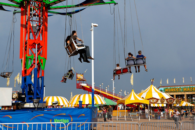 Families, couples and individuals enjoy the Larimer County Fair in Loveland Friday, August 4, 2017. (Michelle Risinger/ Loveland Reporter-Herald)