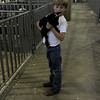 Tate Shearer carries his kid, Adelaide, back to her pin Wednesday, August 2, 2017 after showing his goats at the Larimer County Fair in Loveland. (Michelle Risinger/ Loveland Reporter-Herald)