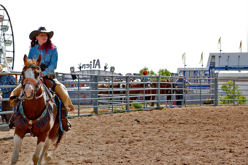 Faith Cavanaugh, 11, makes her way through the arena Saturday, August 5, 2017 on the back of Mancha for the mounted shoot at the Larimer County Fair. (Michelle Risinger/ Loveland Reporter-Herald)