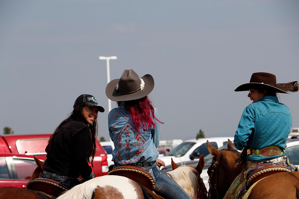 . Katrina Gurule,10, left, Faith Cavanaugh, 11, center, and Gwenie Repphun, 13, right prepare for the mounted shoot Saturday, August 5, 2017 at the Larimer County Fair. (Michelle Risinger/ Loveland Reporter-Herald)