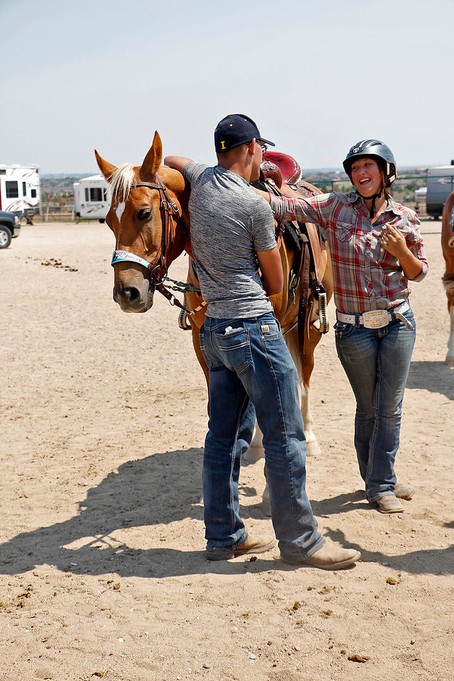Haley Fisher, 17, right, celebrates her performance in barrels Wednesday, August 2, 2017 at the Larimer County Fair with Colton Buckridge, 17, left, and her horse, Whiskey. She has been riding Whiskey for about four months and this is his second fair. (Michelle Risinger/ Loveland Reporter-Herald)