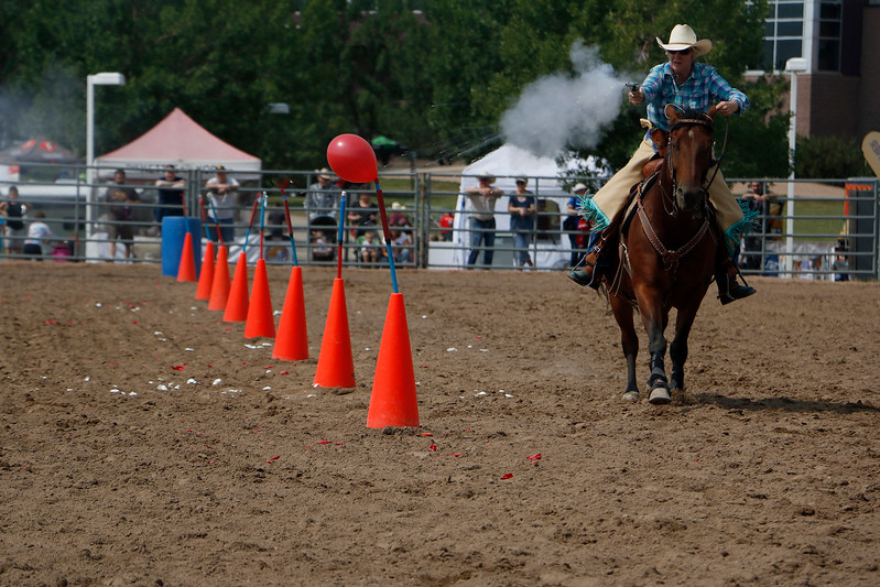Marjie Dones takes her horse, Dray-go, through the arena Saturday, August 5, 2017 during the mounted shoot at the Larimer County Fair. (Michelle Risinger/ Loveland Reporter-Herald)