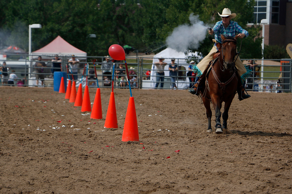 . Marjie Dones takes her horse, Dray-go, through the arena Saturday, August 5, 2017 during the mounted shoot at the Larimer County Fair. (Michelle Risinger/ Loveland Reporter-Herald)