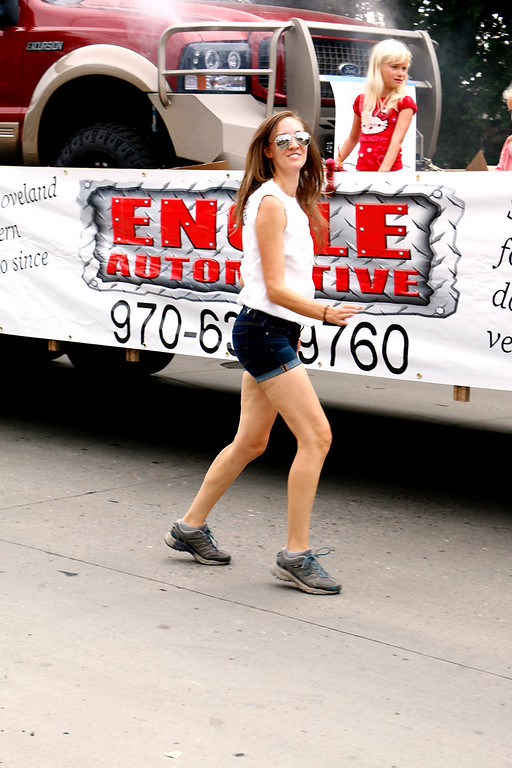. Rachel Shield of Loveland dances her way through the Larimer County Fair Parade Saturday, July 29, 2017 along side the Engle Automotive float. The float won second place for in the commercial category. (Michelle Risinger/ Loveland Reporter-Herald)