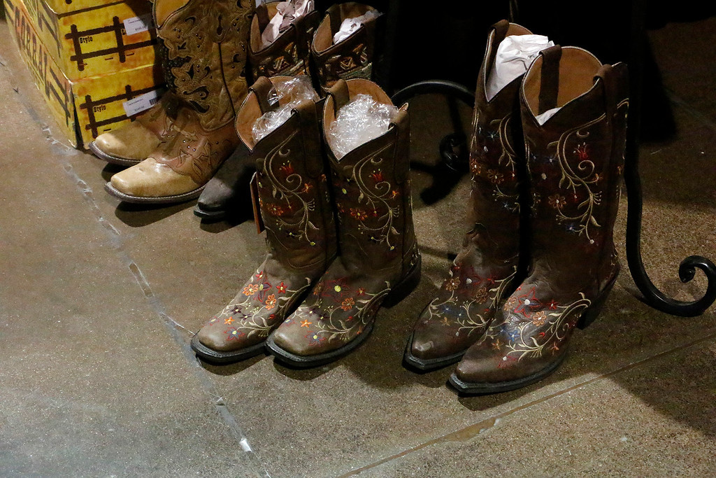 . Boots and belt buckles find their way to the Larimer County Fair on Friday, August 4, 2017 in the Vendor\'s Market. (Michelle Risinger/ Loveland Reporter-Herald)