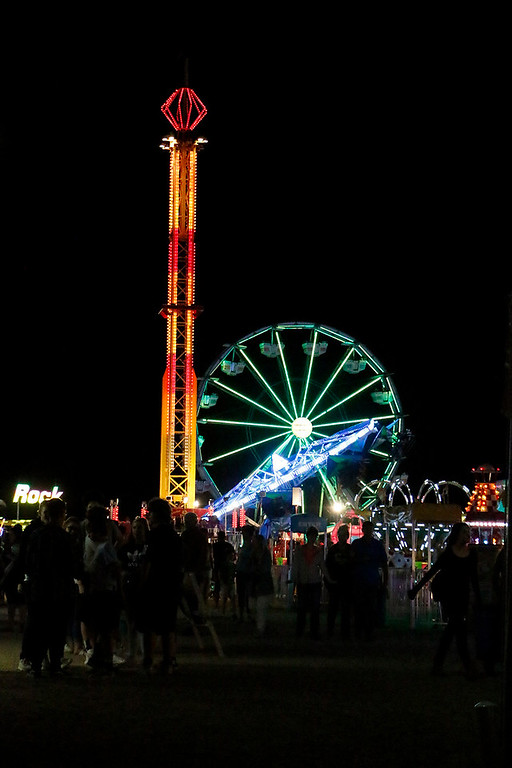 . Larimer County Fair goers enjoy the rides and lights Friday, August 4, 2017 at The Ranch. (Michelle Risinger/ Loveland Reporter-Herald)