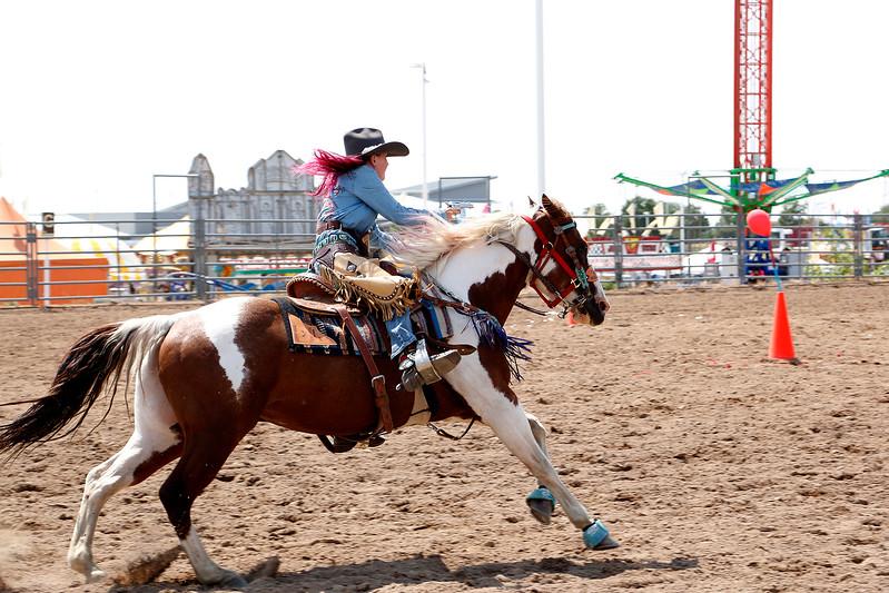 Faith Cavanaugh, 11, rides her horse, Mancha, Saturday, August 5, 2017 through the mounted shoot course at the Larimer County Fair. (Michelle Risinger/ Loveland Reporter-Herald)