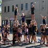 Members of the Rockets from the Rocky Mountain Cheer and Dance Company strike a pose on Cleveland Avenue during the Larimer County Fair Parade in downtown Loveland on Saturday morning, July 30, 2016. (Photo by Craig Young / Loveland Reporter-Herald)