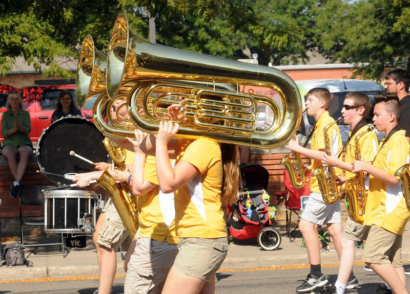Members of the Thompson Valley High School marching band play a rousing tune as they march in the Larimer County Fair Parade through downtown Loveland on Saturday morning, July 30, 2016. (Photo by Duncan Young / for the Reporter-Herald)