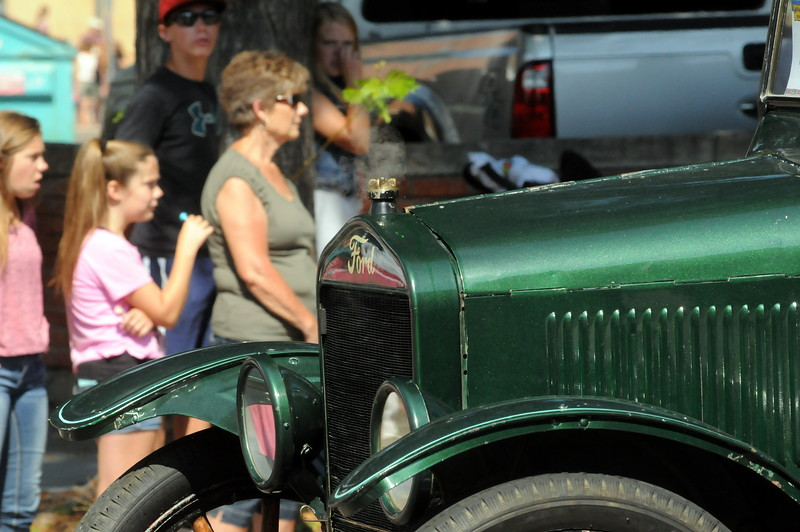A classic Ford rolls past parade watchers during the Larimer County Fair Parade through downtown Loveland on Saturday morning, July 30, 2016. (Photo by Duncan Young / for the Reporter-Herald)