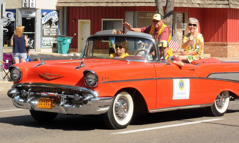 Members of the Loveland Lions Club ride in an old Chevy during the Larimer County Fair Parade through downtown Loveland on Saturday morning, July 30, 2016. (Photo by Duncan Young / for the Reporter-Herald)
