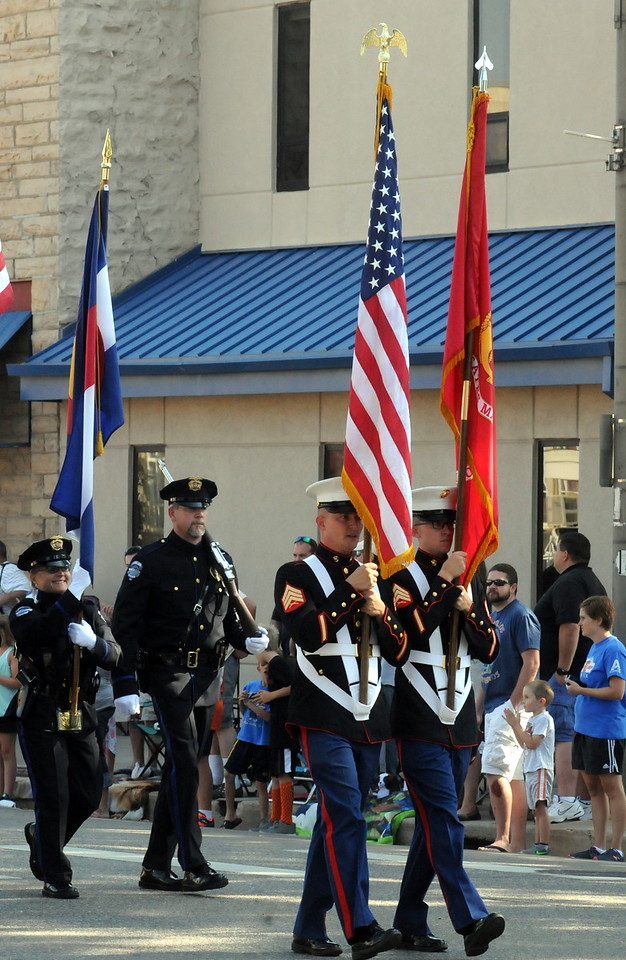Members of the color guard carry the flags at the start of the Larimer County Fair Parade through downtown Loveland on Saturday morning, July 30, 2016. (Photo by Duncan Young / for the Reporter-Herald)