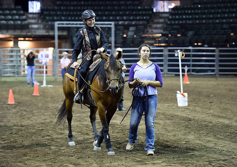 Madisen Harris, 13, leads her aunt, Joan Day, as she rides her quarter horse, Ginn Starlight, while competing in the Theraputic Riding event at The Freedom Horse Show Friday, Aug. 3, 2018, during the Lairmer County Fair at The Ranch in Loveland.   (Photo by Jenny Sparks/Loveland Reporter-Herald)