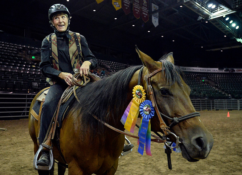 Joan Day smiles at her family after she and her horse, Ginn Starlight, won first place ribbons in the Theraputic Riding event at The Freedom Horse Show Friday, Aug. 3, 2018, during the Lairmer County Fair at The Ranch in Loveland.  (Photo by Jenny Sparks/Loveland Reporter-Herald)