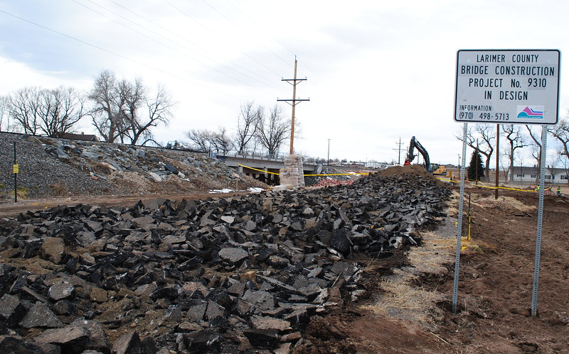Construction crews have torn up a section of County Road 25 leading toward a bridge over the Little Thompson River that is currently being replaced, one of several 2013 flood repairs that are underway this winter. (Pamela Johnson / Loveland Reporter-Herald)