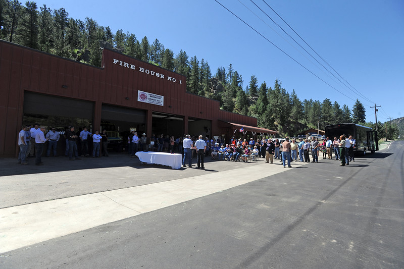 Poeple gather fo the ribbon cutting to celebrate the opening of County Road 43 on Thursday, July 14, 2016 in Glen Haven. The road, which was damaged during the flood in 2013, opened after it was reconstructed. (Photo by Jenny Sparks/Loveland Reporter-Herald)