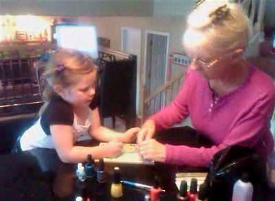 Lili Boshell and Carole painting Lili's nails.