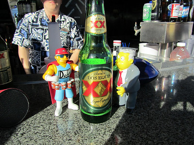 Dos XX at the poolside bar. Duff was insisting that his belt get filled before any further moves are made by Larry.