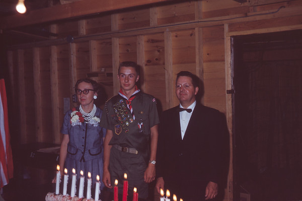 1962 - July 24. Madelyn, John, & Arne Larson. John received Eagle Scout Rank at this meeting. Slide 62-884.