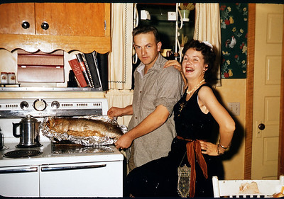 October 20, 1957. Dave & Irene with baked Muskie. Slide 291.
