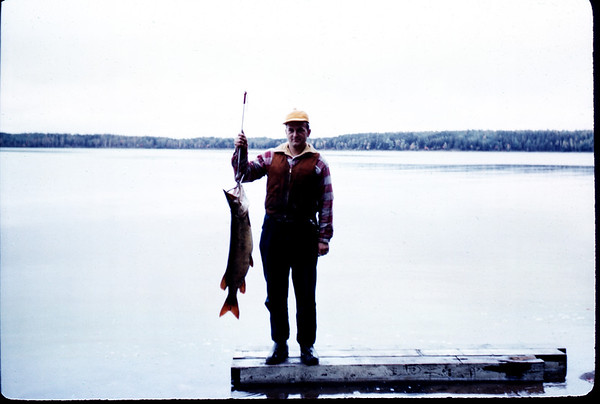 September 21, 1957. David Lastofka with 18# Muskie. Sand Lake. Slide 284