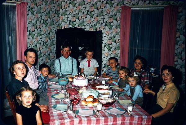 1956.  Slide 122. Larson Family.  Sig, Madalyn, Dave LaStofka, Eric, Clarence, John, Larry, Linda, karen, Ruth, Irene.