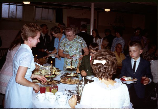 June 28, 1970. Sigrid, Elva, and Nancy serving lunch.