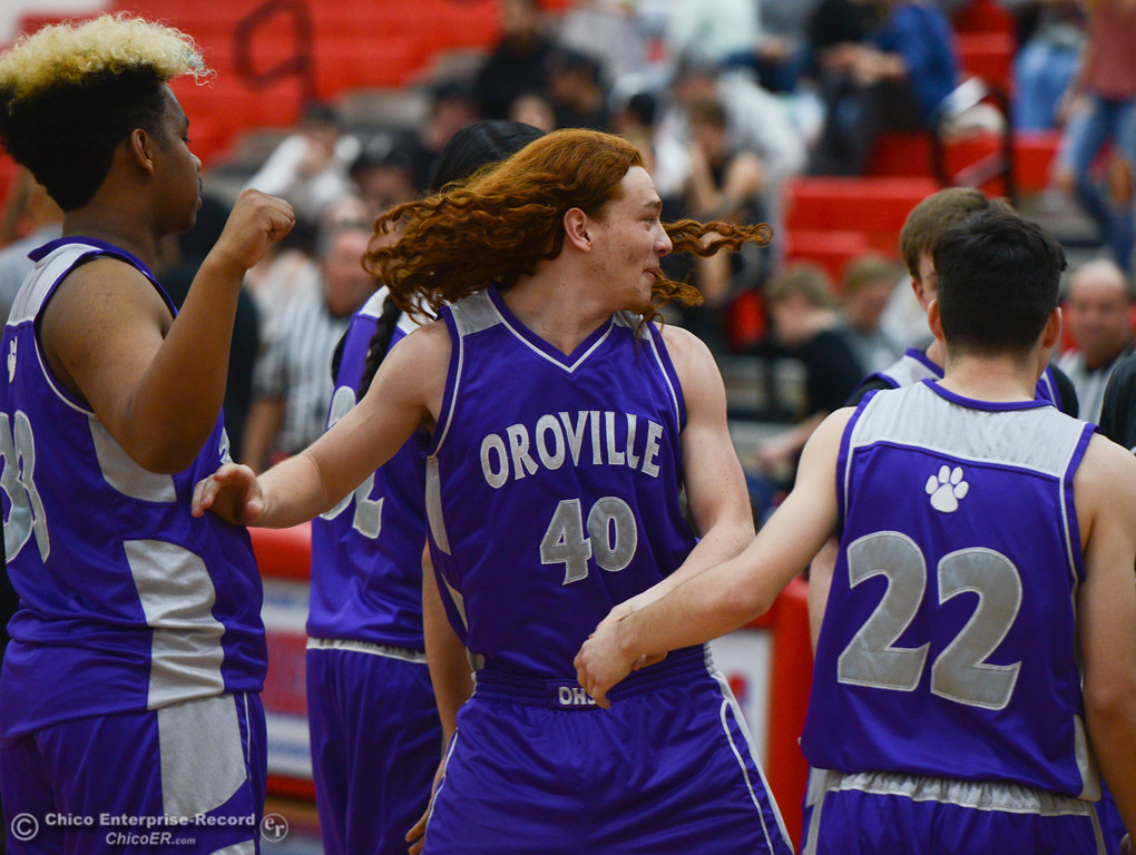 . Oroville High\'s Trent Roosevelt (40) high-fives his teammates as the game is about to start, Friday, February 16, 2018, in Oroville, California. (Carin Dorghalli -- Enterprise-Record)