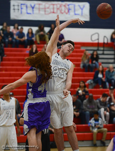 Oroville High's Trent Roosevelt (40) and Las Plumas High's Sullivan Hurte (25) during jump ball, Friday, February 16, 2018, in Oroville, California. (Carin Dorghalli -- Enterprise-Record)