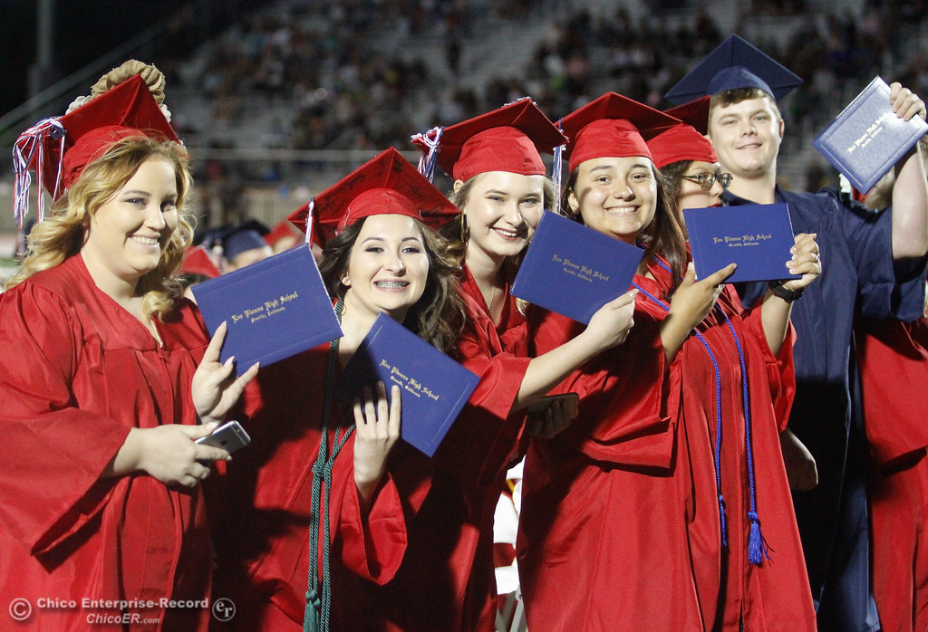 . Excited Las Plumas High School graduates smile with their diplomas during the class of 2017 commencment ceremony Friday June 9, 2017 at Harrison Stadium in Oroville, California. (Emily Bertolino -- Mercury Register