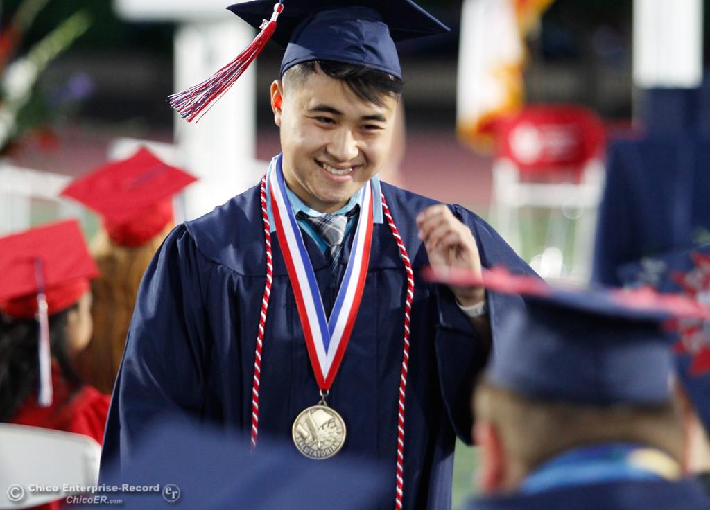 . Las Plumas High School salutatorian Minh Tham smiles after his speech during the commencment ceremony Friday June 9, 2017 at Harrison Stadium in Oroville, California. (Emily Bertolino -- Mercury Register