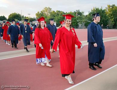 Tje Las Plumas High School graduating class of 2017 enter their commencment ceremony Friday June 9, 2017 at Harrison Stadium in Oroville, California. (Emily Bertolino -- Mercury Register