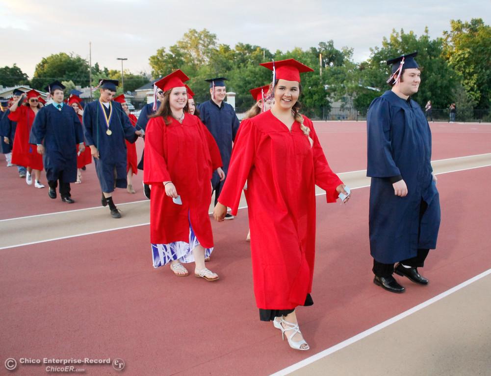 . Tje Las Plumas High School graduating class of 2017 enter their commencment ceremony Friday June 9, 2017 at Harrison Stadium in Oroville, California. (Emily Bertolino -- Mercury Register
